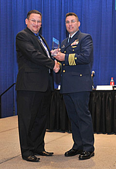 USCG CAPT LeBlanc (right) receives the 2012 Legacy Award from Task Force Member Scott Schaefer